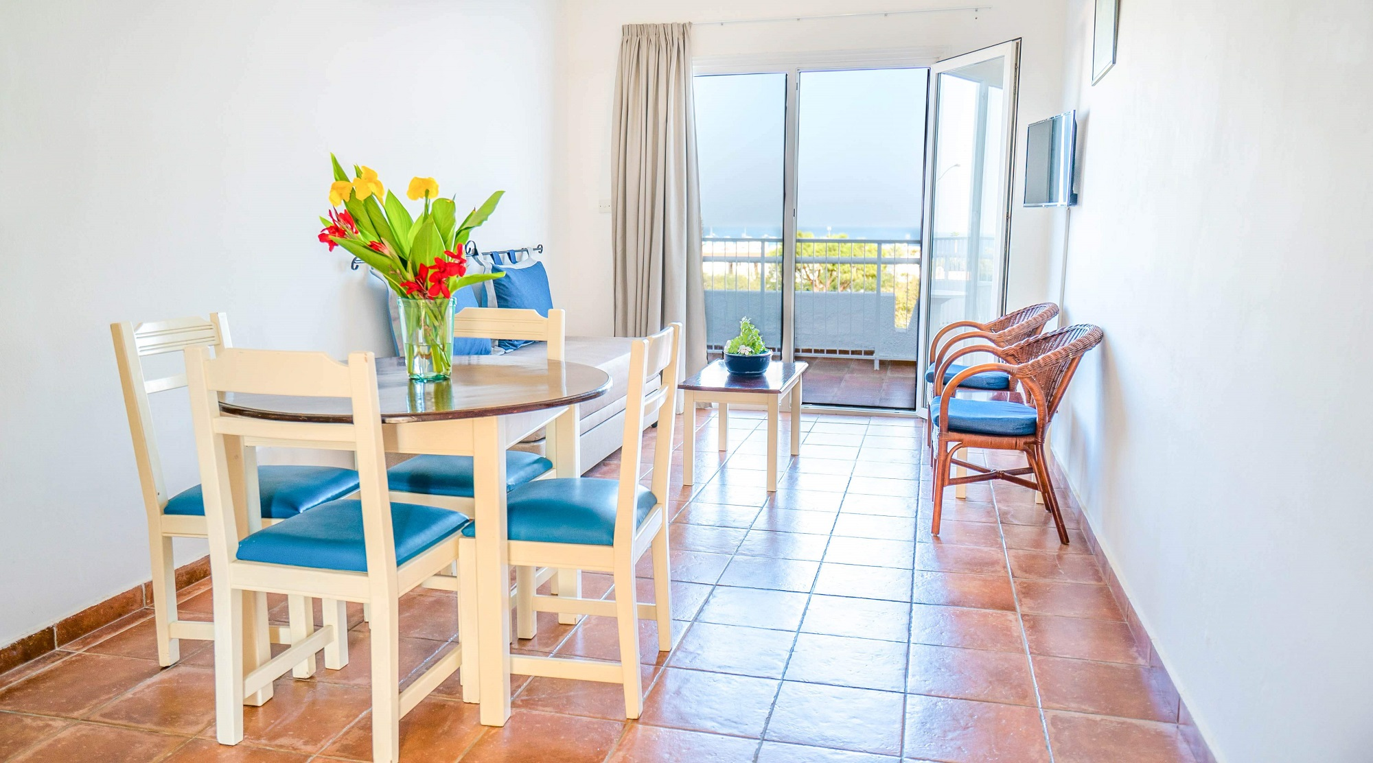 Living room and balcony view on Andreotis Apartments Protaras