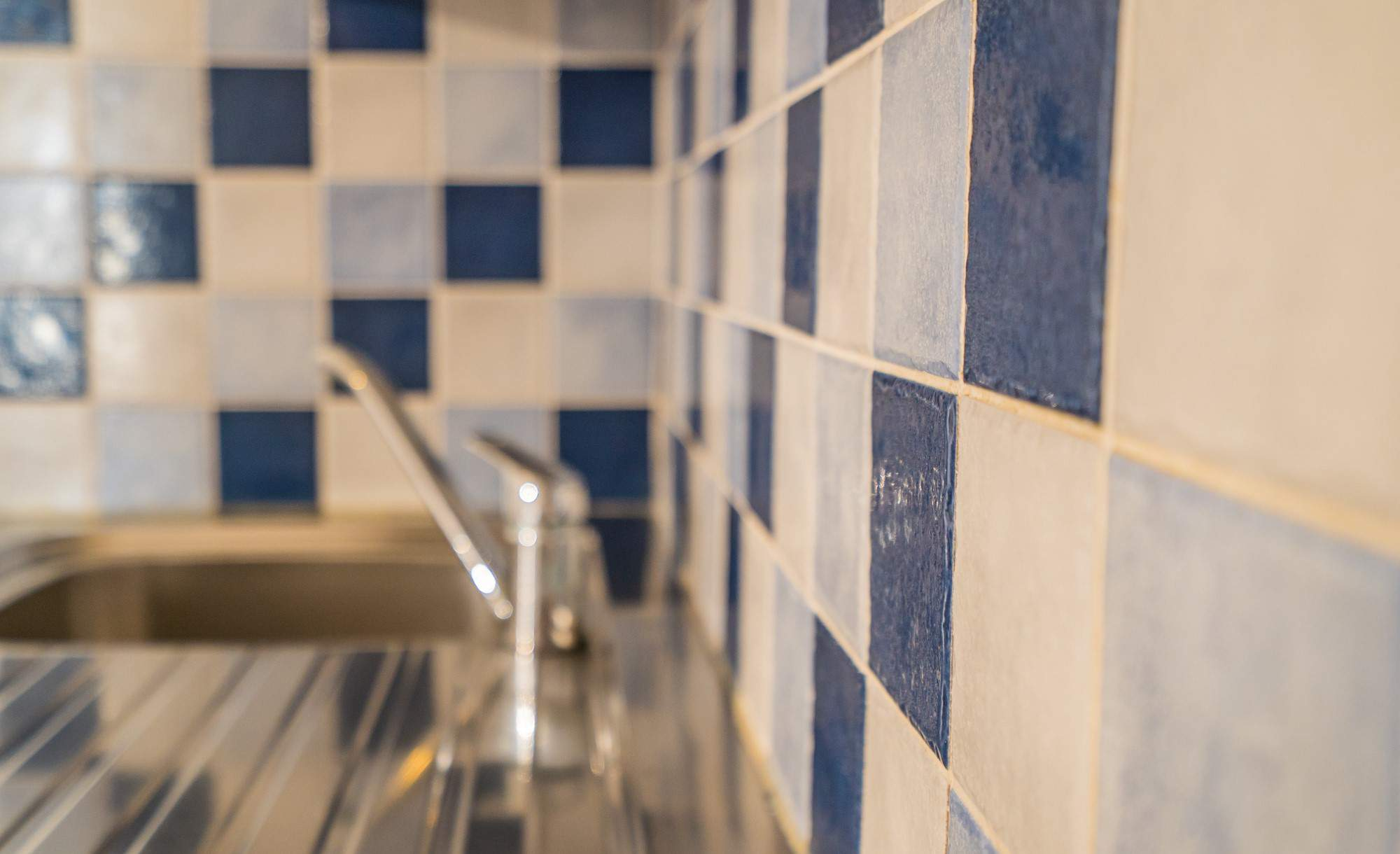 The photo shows a modern bathroom and colorful tiles